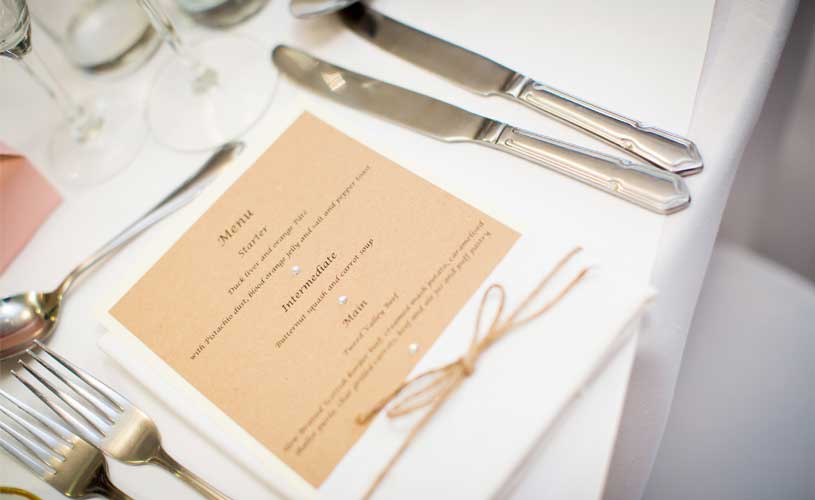 knives and forks at wedding event